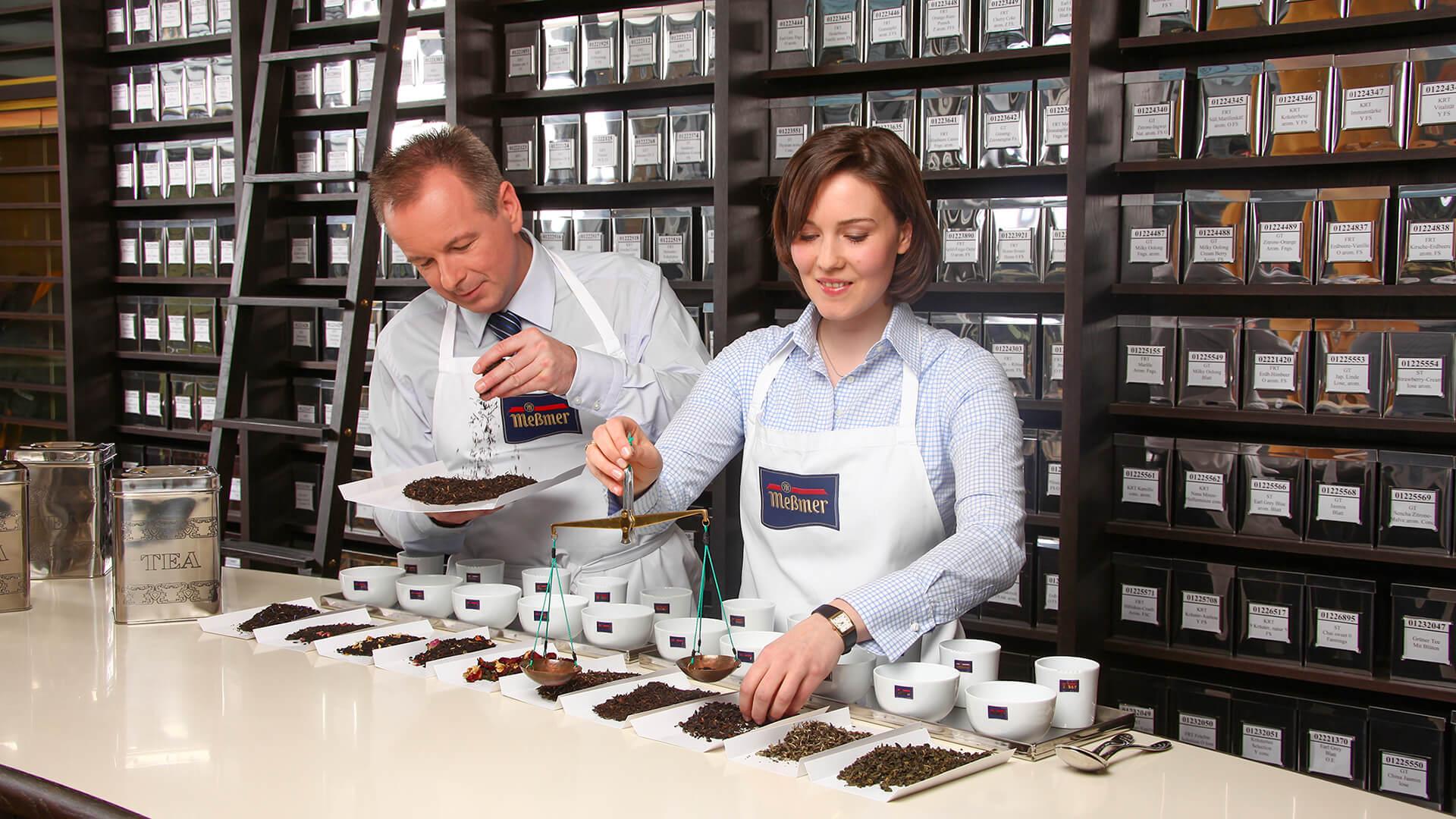 Man and woman working on tea testing